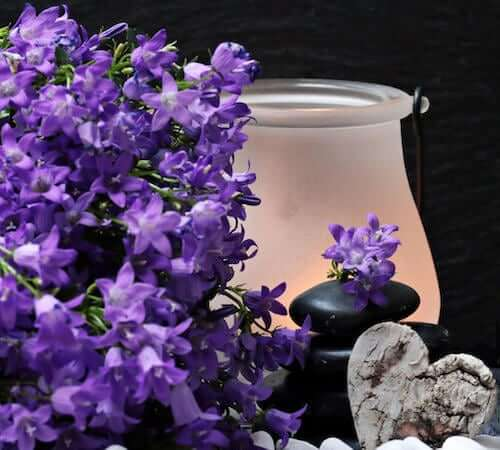 Candle surrounded by lavender flowers
